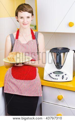 Cute Baking Woman Holding Fresh Bread In Kitchen