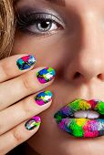 Half face of attractive girl with beautiful multicolor holographic Minx nails and bright colorful make-up poster