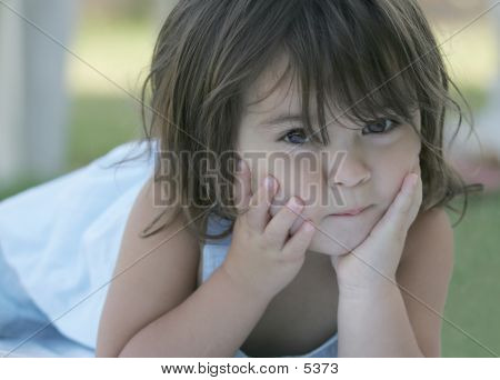 Little Girl Posed Lay On Ground
