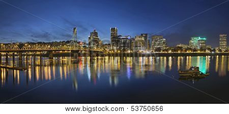 Portland Oregon Downtown Skyline with Hawthorne Bridge Along the Banks of Willamette River at Evening Blue Hour Panorama poster