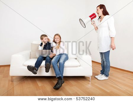 Outrageous mom screaming at kids with laptop using megaphone poster