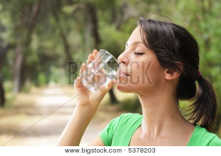 Young Woman Drinking With Water Glass