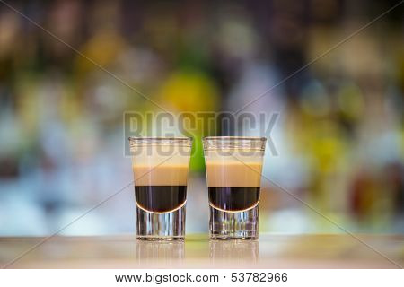 Pair of B52 shots on a bar