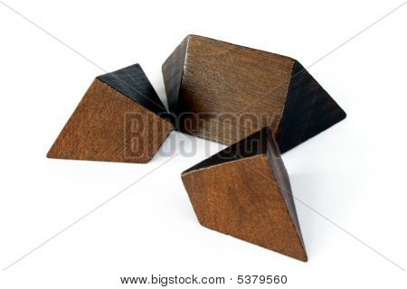 A wooden puzzle on an isolated white background poster
