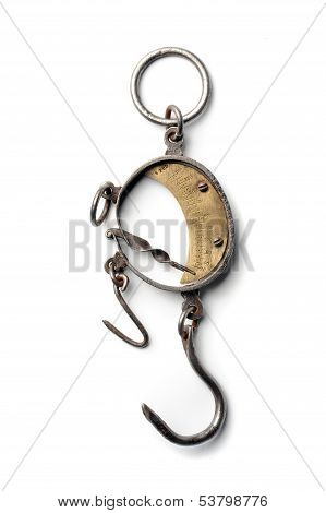 Vintage scales with hook balancing at white background