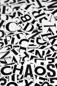Macro shot of a clipped letters formed the word chaos poster