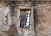 Old abandoned building facade wall with empty window poster