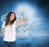 Composite image of cheerful attractive brunette wearing casual clothes pointing poster