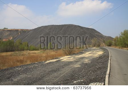 Road going to the heap of mine