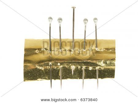 Photo Of Five Isolated Pins Over White Background.