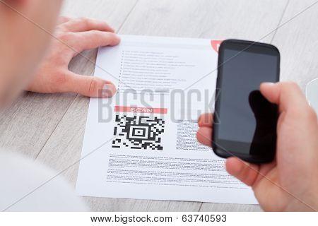 Man Scanning Barcode