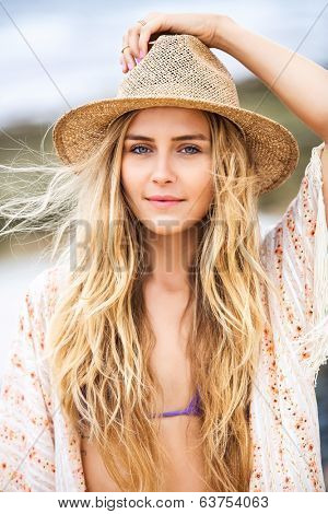 Fashion lifestyle, Attractive woman in bikini and sun hat at the beach