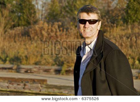 Mature Man Wearing Sunglasses