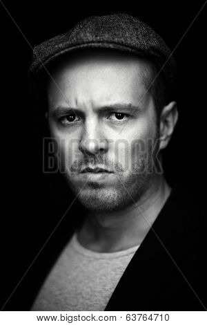 Vertical portrait of serious guy looking at camera