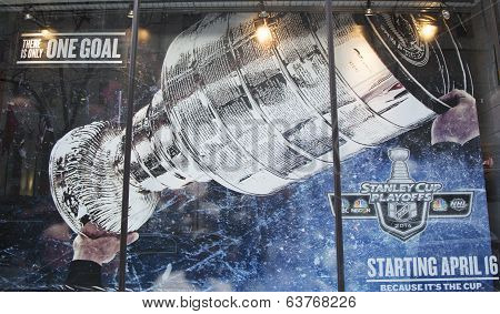 Stanley Cup Playoffs 2014 logo displayed at the NBC Experience Store window in midtown Manhattan