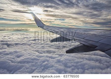 Sunset, Clouds And Wing