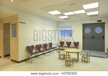 Modern building wating area with metallic chairs and chidren table. Horizontal. poster