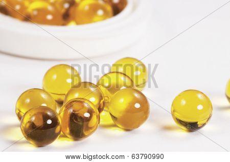 Yellow Capsules Near The Box