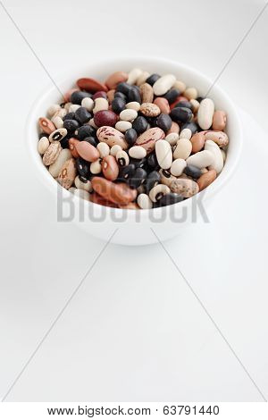 Assorted Dried Beans In A Bowl Isolated On White Background