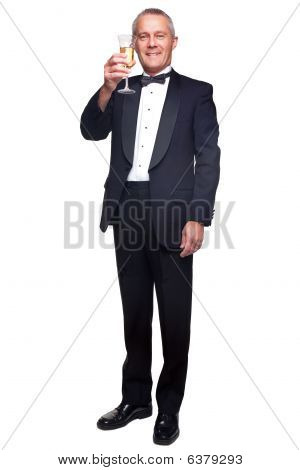 Mature Man In Tuxedo Drinking Champagne.