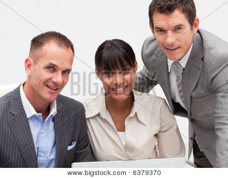Business Team Working Together With A Computer