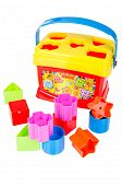 Shape sorter toy with various coloured blocks isolated on white background poster