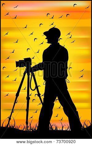 Photographer Shooting At Sunset