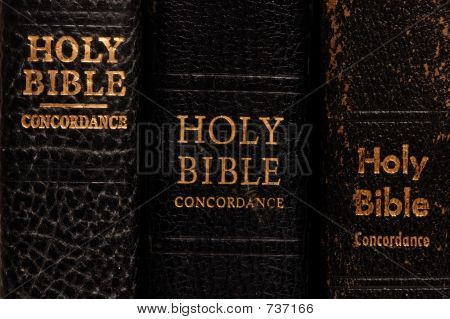 Three Old Bibles on Edge Close Up