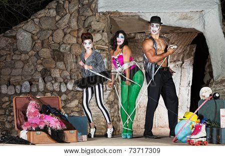 Clowns Tying Up Woman