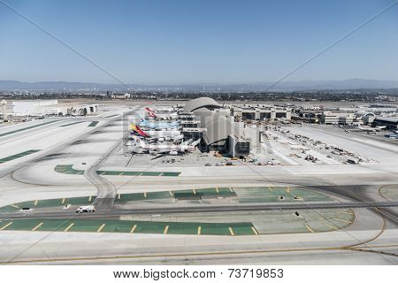 LOS ANGELES, CALIFORNIA - September 11, 2014:  Large planes lined up at the newly renovated Tom Bradley terminal at LAX.