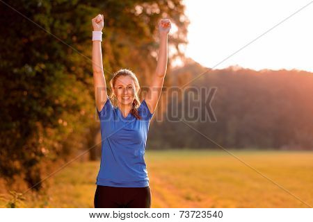 Jubilant Young Woman Punching The Air