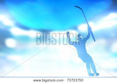 Hockey player celebrating goal, victory with hands and stick up in the air. Win the match. Full arena night lights