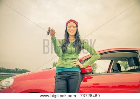 Asian Woman Showing Car Keys
