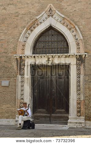 Musician In Front Of San Gregorio Church