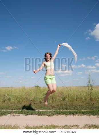 Jumping Girl Against Blue Sky
