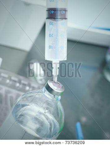 Syringe In The Vial.