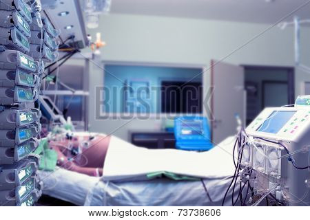 Patient in sickbed in ICU at the hospital