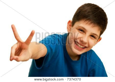Happy Handsome Teen Showing A Victory Sign