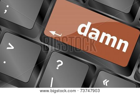 Close-up Computer Keyboard Keys With Damn Word