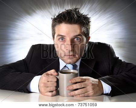Addict Businessman Holding Cup Of Coffee Anxious And Crazy In Caffeine Addiction