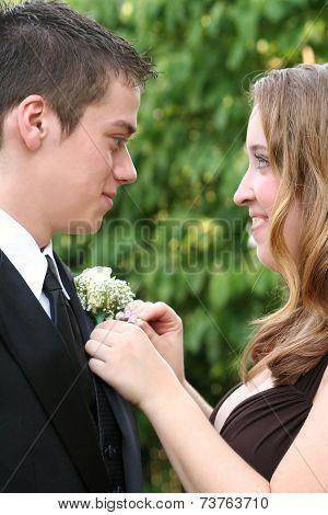 Prom Girl Fixing Date's Flower 2