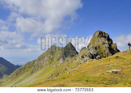 Hiking mon alpine crest against blue sky