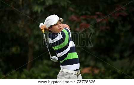 KUALA LUMPUR, MALAYSIA - OCTOBER 11, 2014: Haru Nomura of Japan tees off at the fourth hole of the KL Golf & Country Club during the 2014 Sime Darby LPGA Malaysia golf tournament.