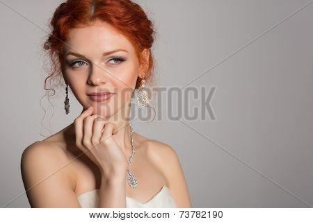 Redheaded bride slyly looking away