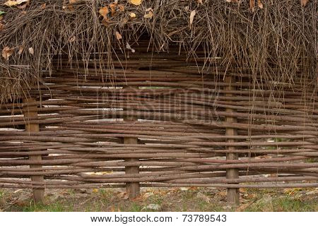 A woven willow wicker fence panel suitable for gardening background or wallpaper. Copy space text