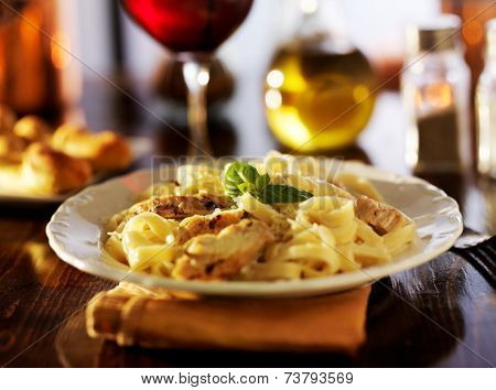 fettuccine alfredo with grilled chicken dinner at night poster
