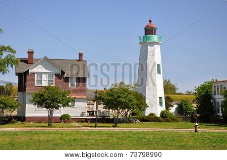 Old Point Comfort Lighthouse and keeper's quarters in Fort Monroe, Chesapeake Bay, Virginia, USA poster