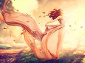 Beauty Autumn Woman, beautiful fantasy girl, fairy in blowing transparent chiffon dress. Fall. Fashion model lady in windy autumn park poster