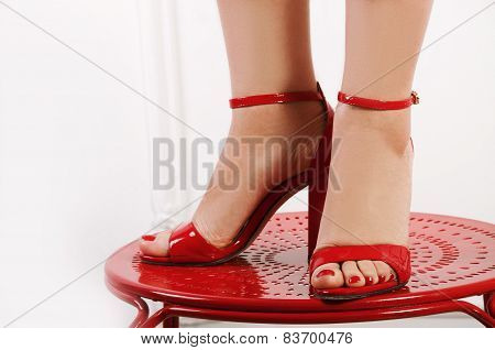 Woman's Bare Feet In Red Peep-toes