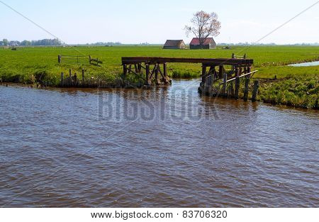 Dutch countryside with waterway and gateway
